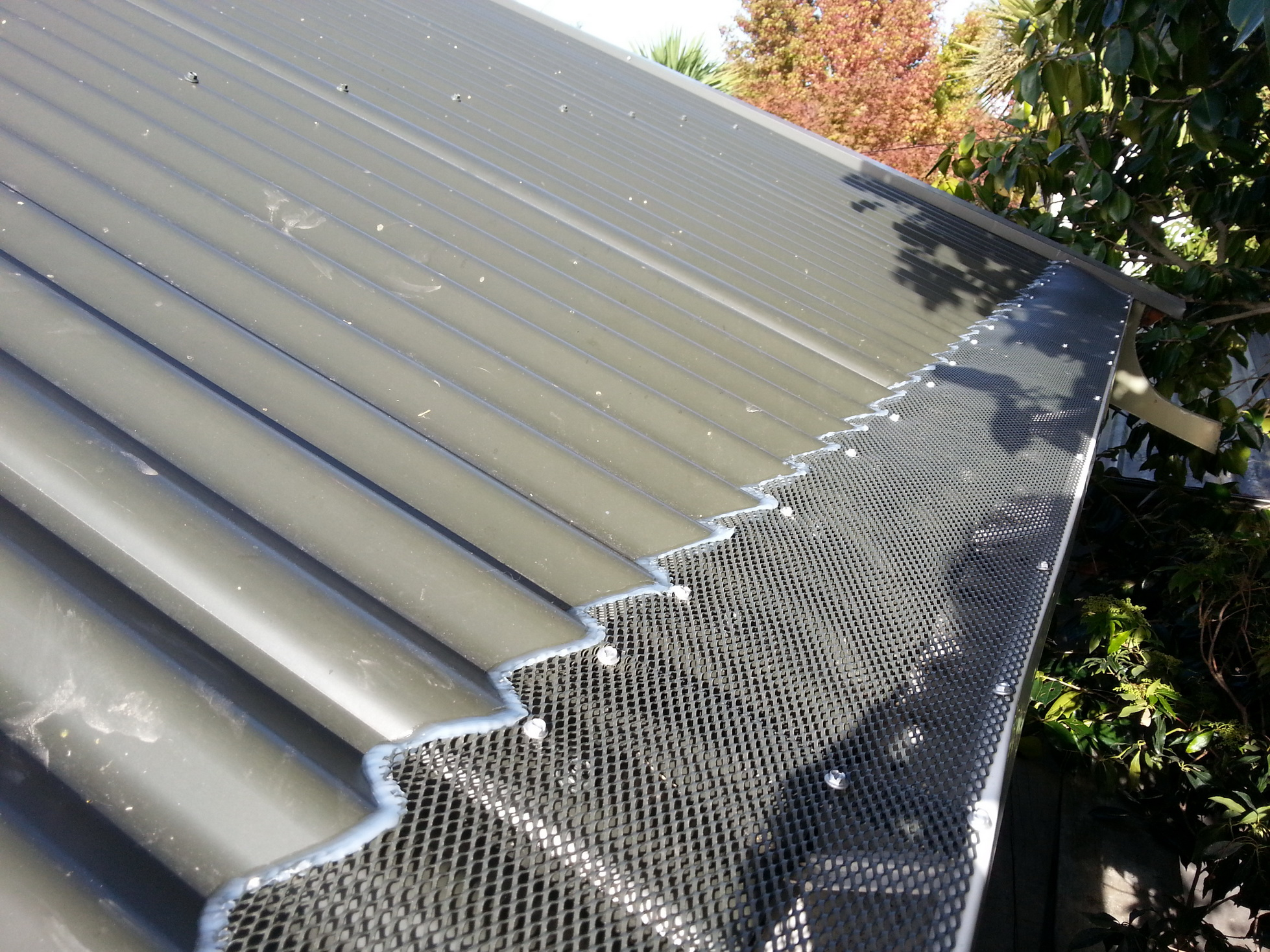 Call Rohan Rudd GumLeaf Gutter Guard Installers. Corrugated Roof Gutter Guard Christchurch Canterbury and Otago regions.